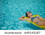 a woman in the pool floats on a ... | Shutterstock . vector #649143187