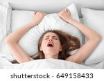 beautiful woman lying in bed | Shutterstock . vector #649158433