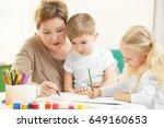 happy senior woman painting...   Shutterstock . vector #649160653