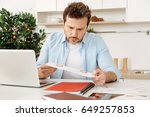 serious bristled man reading... | Shutterstock . vector #649257853