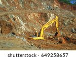 Small photo of Next to Lake Izabal, Guatemala - 30 March, 2017: Excavator LiuGong digging and mixing laterite nickel ore on the ore stockpile yard.