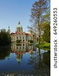 Stock photo the city hall rathaus of hannover reflected in pool on sunny spring day 649260553