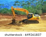 Small photo of Next to Lake Izabal, Guatemala - 30 March, 2017: Excavator ELG-05 digging and mixing laterite nickel ore on the ore stockpile yard.