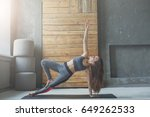 woman in side plank at yoga... | Shutterstock . vector #649262533