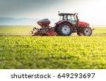 Farmer With Tractor Seeding  ...
