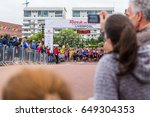 a group of runners wait at the... | Shutterstock . vector #649304353