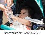 baby riding a stroller  | Shutterstock . vector #649306123