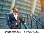 happy businessman looking at... | Shutterstock . vector #649307653