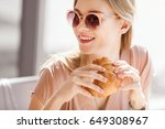 young woman eating croissant... | Shutterstock . vector #649308967