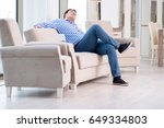 young man shopping in furniture ... | Shutterstock . vector #649334803
