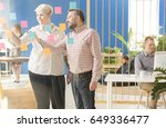 two co workers talking about... | Shutterstock . vector #649336477