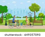 couple riding bicycles in... | Shutterstock .eps vector #649357093