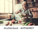 beautiful mature woman in apron ... | Shutterstock . vector #649360807