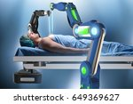 surgery performed by robotic arm | Shutterstock . vector #649369627