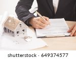 businessman signing a mortgage  ... | Shutterstock . vector #649374577