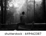 A Lone Man Sitting In Forest...