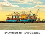 container ship at sunset in... | Shutterstock . vector #649783087