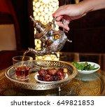 black tea in the tea pot with... | Shutterstock . vector #649821853