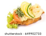 Danish specialties and national dishes, high-quality open sandwich, isolated on white background. fish fillet and garnished with remoulade and lemon