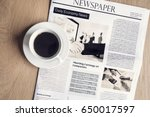 newspaper with coffee on table | Shutterstock . vector #650017597