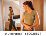 beautiful woman checking her... | Shutterstock . vector #650025817