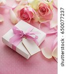 gift box tied with pink ribbon... | Shutterstock . vector #650077237