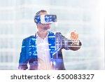 man in vr headset working in... | Shutterstock . vector #650083327