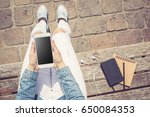 woman using white smartphone... | Shutterstock . vector #650084353