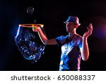 man shows a show of soap... | Shutterstock . vector #650088337