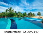swimming pool with hotel. | Shutterstock . vector #650092147