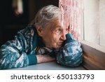 sad elderly woman sitting near... | Shutterstock . vector #650133793