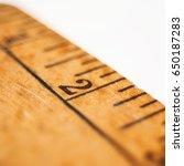 close shot of an old yardstick... | Shutterstock . vector #650187283