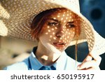 woman in hat  on woman's face... | Shutterstock . vector #650195917