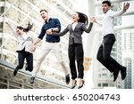 young business team jumping for ... | Shutterstock . vector #650204743
