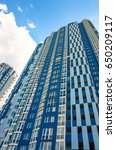 facade of a tall residential... | Shutterstock . vector #650209117