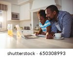 father and daughter using... | Shutterstock . vector #650308993