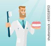 caucasian dentist showing a... | Shutterstock .eps vector #650318953
