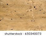 old log with woodworm holes and ... | Shutterstock . vector #650340073