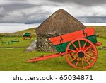 Isle of Skye: museum with old huts and carts in nature near the ocean with dramatic sky. Typical for Isle of Skye - stock photo