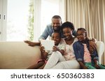 parents and son using digital... | Shutterstock . vector #650360383