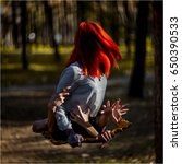 the red haired girl crawls out...