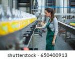 female factory worker... | Shutterstock . vector #650400913