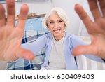 closeup of elderly woman making ... | Shutterstock . vector #650409403