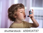 boy using asthma inhaler to... | Shutterstock . vector #650414737