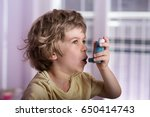 boy using asthma inhaler to... | Shutterstock . vector #650414743