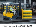factory worker loading packed... | Shutterstock . vector #650419477