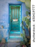 Blue Wall With Turquoise Door