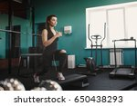 young fitness woman in the gym. ...   Shutterstock . vector #650438293