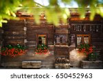 Wooden House With Flowers And...