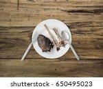 Catfish Bones On White Dish....